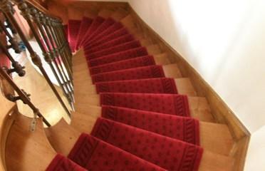 Sols service - Orleans - Pose de tapis laine avec tringles laiton